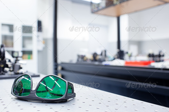 quantum optics lab - shallow DOF; selective focus on the protect - Stock Photo - Images