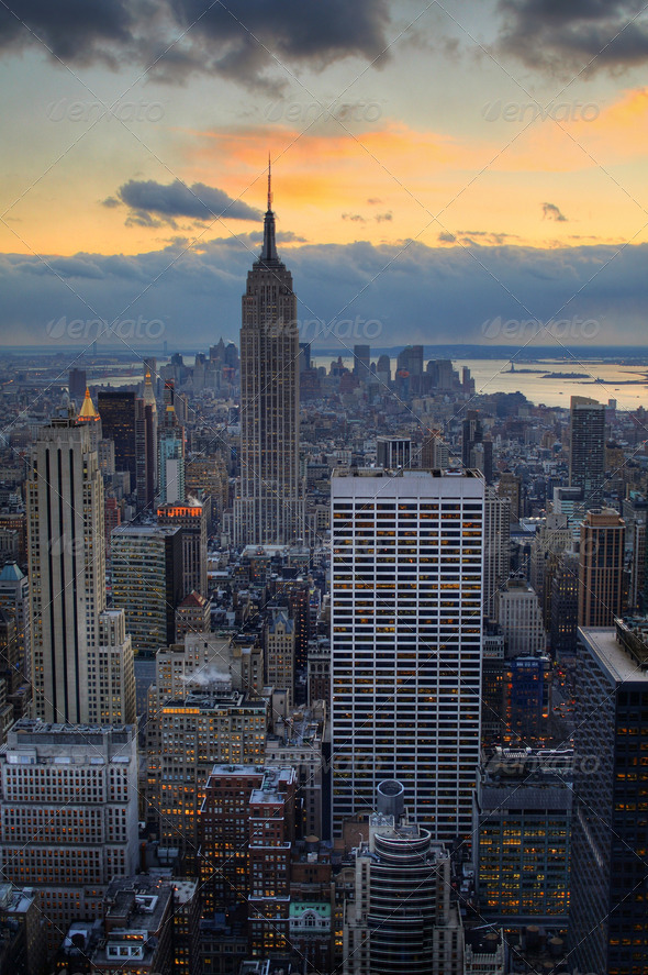 Midtown Manhattan with Empire State Building at dusk - Stock Photo - Images