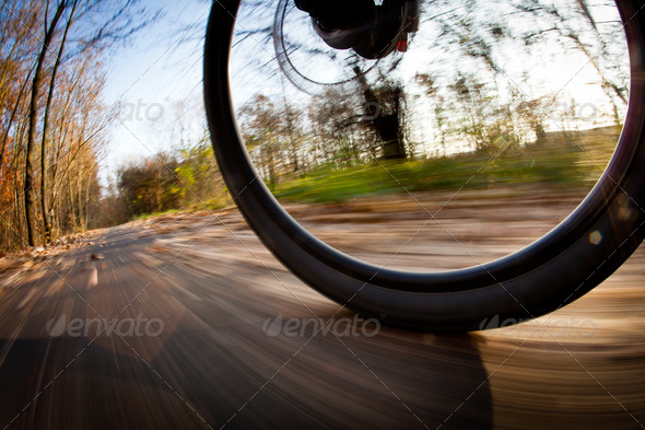 Bicycle riding in a city park on a lovely autumn/fall day (motio - Stock Photo - Images