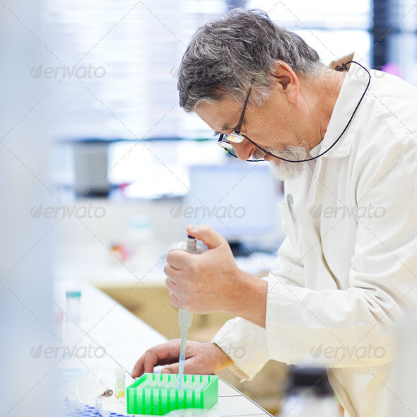 senior male researcher carrying out scientific research in a lab - Stock Photo - Images