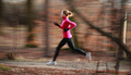 Young woman running outdoors in a city park on a cold fall/winte - PhotoDune Item for Sale