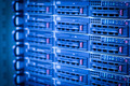Server rack cluster in a data center (shallow DOF; color toned i