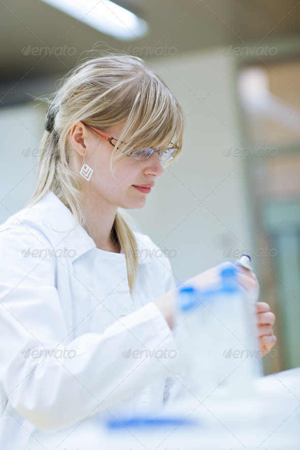 Closeup of a female researcher carrying out research experiments - Stock Photo - Images