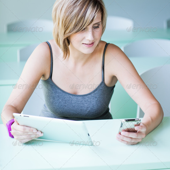 Pretty college student/businesswoman working on her tablet compu - Stock Photo - Images