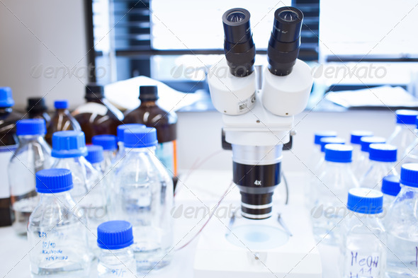 chemistry lab (shallow DOF; focus on the beakers in the foregrou - Stock Photo - Images