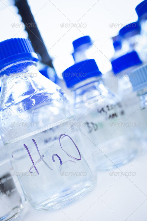 Glassware in a chemistry lab (shallow DOF; focus on the beakers - Stock Photo - Images
