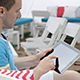 Young Man Typing on the Tablet in Nature - VideoHive Item for Sale