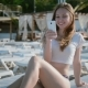 Young Woman Using Cellphone While Lying On Sunbed On Beach - VideoHive Item for Sale