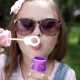 Little Girl Blowing Soap Bubbles In Summer Park. - VideoHive Item for Sale