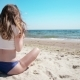 Girl With Mobile Phone Sitting On Sand Near Sea And Blue Sky - VideoHive Item for Sale