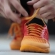 The Athlete Tying Shoelaces On Sneakers. Preparation For The Exercise. . - VideoHive Item for Sale