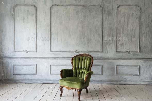 One classic armchair against a white wall and floor. Copy space - Stock Photo - Images