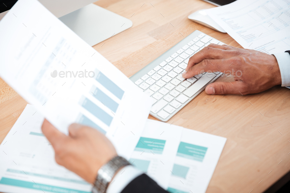 Close-up portrait of men's hands typing on keyboard - Stock Photo - Images