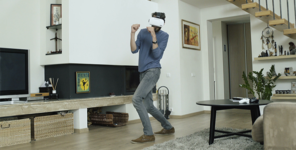 6947a08dfc73 Man Playing Boxing Game In Virtual Reality by StockHunter