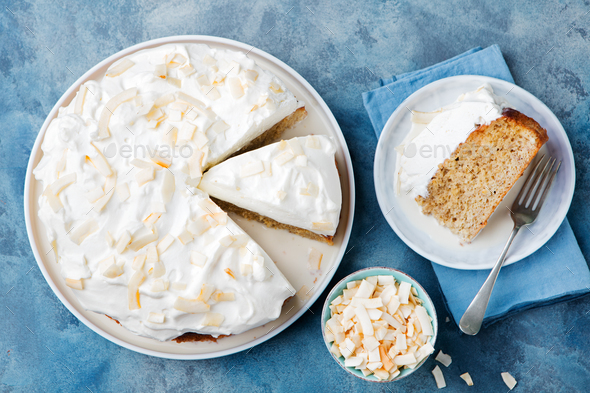 Three milk cake, tres leches cake with coconut. Traditional dessert of Latin America Top view - Stock Photo - Images