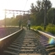 Two Male Friends Walking With Their Bikes On The Rails At The Railway In Sunset And Talking - VideoHive Item for Sale