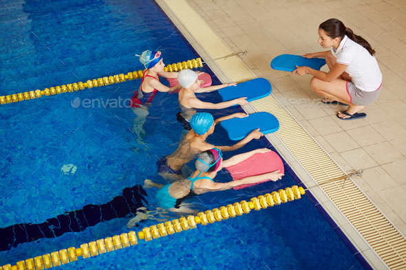 Swimmers with coach - Stock Photo - Images