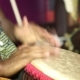 Person Playing On Jambe Drum No Face.  Of Man's Hands Drumming Out a Beat On An African Skin-covered - VideoHive Item for Sale