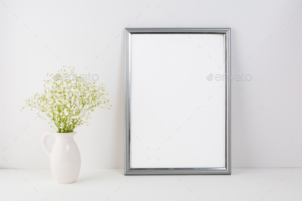 Placeit-Frame mockup with white tender flowers - Stock Photo - Images