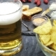 A Glass With Beer And Snacks On a Plate On a Table - VideoHive Item for Sale