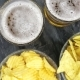 Glass With Beer And Snacks On a Plate On a Table - VideoHive Item for Sale