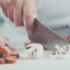 Chef Cutting Mushrooms For Pizza In a Restaurant - VideoHive Item for Sale