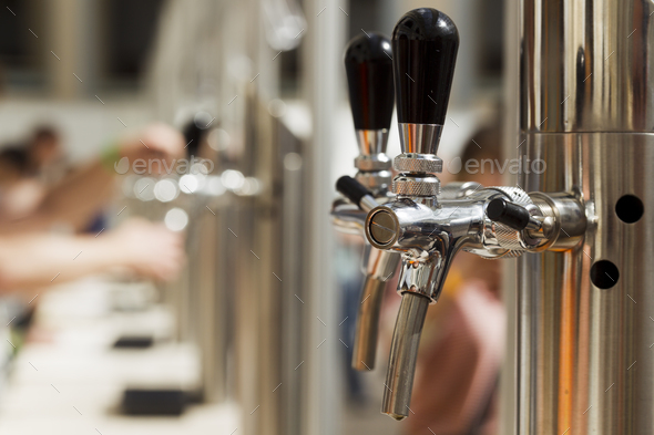 Bright metal beer tap - Stock Photo - Images