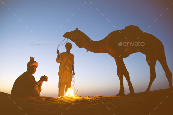 Two Indigenous Indian Men With Their Camel Concept - Stock Photo - Images