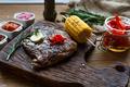 Delicious beef steak on wooden table, close-up