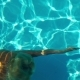 Young Woman Swimming Under Water In The Swimming Pool - VideoHive Item for Sale