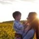 Mother Plays With Son At Field At Sunset.  - VideoHive Item for Sale