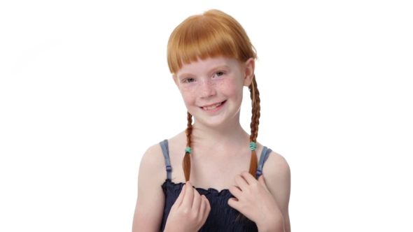 little ginger girl is coquettishly touching her pigtailzdyma4