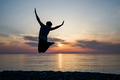 silhouette of teenager jumping in sunset for fun - PhotoDune Item for Sale
