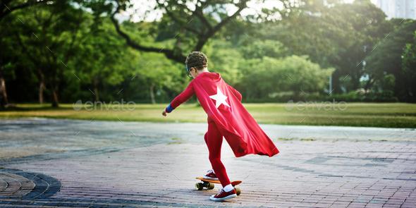 Kid Skateboard Superhero Youth Playful Concept - Stock Photo - Images