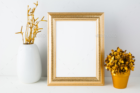 Gold fame mockup with white vase and golden flowerpot - Stock Photo - Images