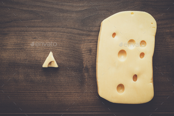 small and big pieces of cheese - Stock Photo - Images