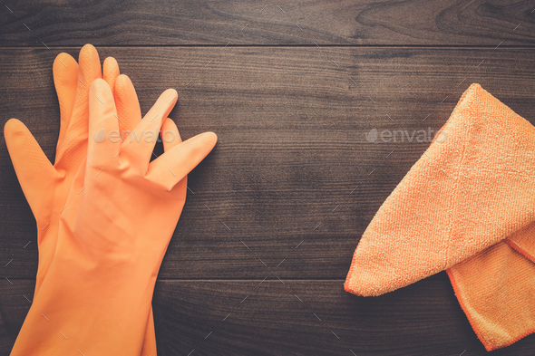 orange rubber cleaning gloves - Stock Photo - Images