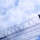 Clouds and Blue Sky Over Barbed Wire - VideoHive Item for Sale