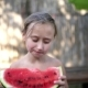 Happy Little Girl Eating Watermelon - VideoHive Item for Sale