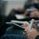 Of Hands Holding Pens And Making Notes At The Conference - VideoHive Item for Sale