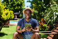 Happy young man listening to music on digital tablet - PhotoDune Item for Sale