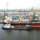 Aerial view of cargo ship in the port with an open hold, awaiting loadin in Saint-Petersburg, Russia - VideoHive Item for Sale