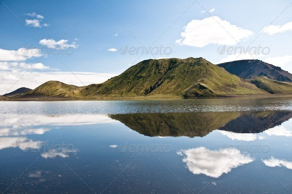 beautiful mountains reflectng in the lake, clouds - Stock Photo - Images