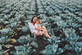 Mother and daughter on the field with cabbage - PhotoDune Item for Sale