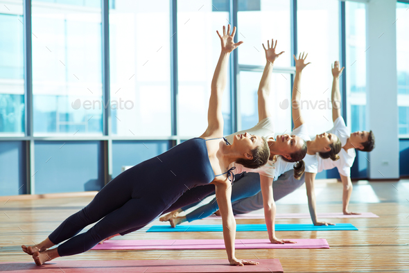 Exercising on mats - Stock Photo - Images
