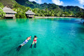 Young couple snorkeling in clean water over coral - PhotoDune Item for Sale