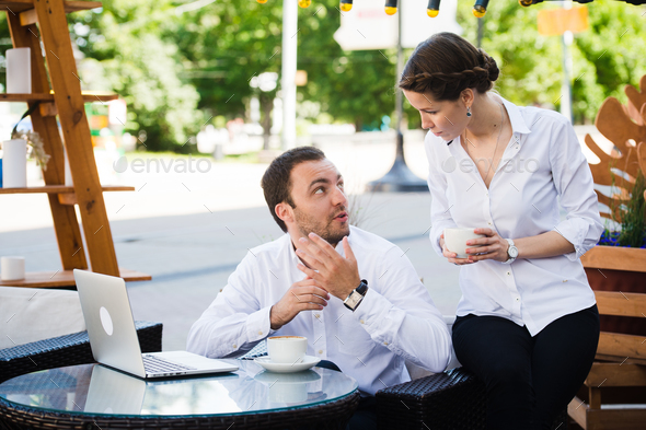 Happy business people on their lunch outside at the coffee shop - Stock Photo - Images
