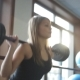 A Woman Squats With a Barbell Behind Head In Front Of Large Windows. - VideoHive Item for Sale