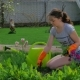 Young Girl Planting Flowers in the Garden - VideoHive Item for Sale