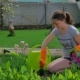 Young Girl Cares For The Lawn Near The House - VideoHive Item for Sale